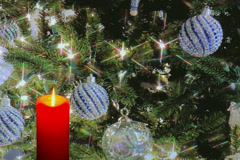 Glowing Red candle with holiday ornaments and decorations Stock Footage