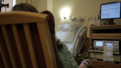 Woman in hospital room with medical equipment Stock Footage