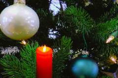 Red candle with holiday ornaments and decorations Stock Footage