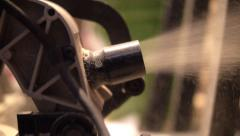 Radial saw spits out sawdust Stock Footage