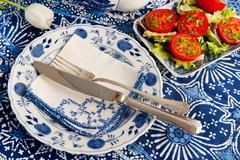 blue crockery with fresh tomatoes - stock photo