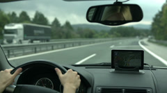 Driving with GPS device on the dashboard Stock Footage