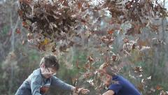 Kids Playing Leaves Stock Footage