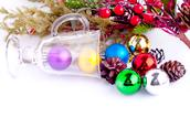 Stock Photo of christmas background with cones, color balls and glass