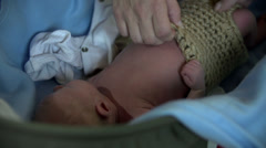 Dressing up small baby in knitwear Stock Footage