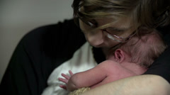 Mother with her baby in her arms Stock Footage