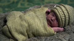 Baby dressed up in brown knitwear from up close in slow motion Stock Footage