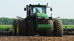 Stock Video Footage of Tractor Giant CU Plowing