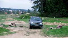 Jeep turns over on driving polygons Stock Footage