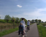 Stock Video Footage of Cyclists along earth rampart fortification near Spaarndam