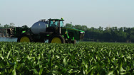 Stock Video Footage of Tractor Sprayer Drive by