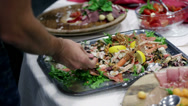 Stock Video Footage of Filling the plate with vegetables and some meat