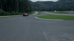 Car driving on a racing track fading in a distance Stock Footage