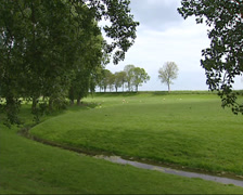 Polder + dike north of Purmerend + cyclists.  Part of Defence Line of Amsterdam Stock Footage