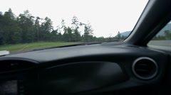 Driving on the racing track from a co-drivers seat Stock Footage