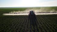 Stock Video Footage of Tractor Sprayer Flyover aerial