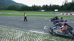 Go-kart drivers are just about to start a race Stock Footage