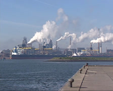 Sea vessel unloading iron ore at Royal Dutch Steelworks at North Sea Canal Stock Footage