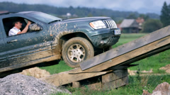 Caravan drives over high obstacle Stock Footage