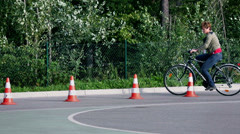 Boy struggles driving over the road obstacles Stock Footage