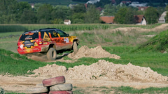 Terrain vehicle driving fast through the bumpy obstacles - stock footage