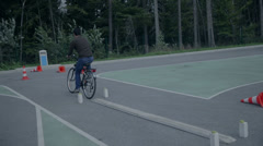 Biking through various obstacles Stock Footage