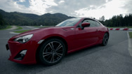 Stock Video Footage of Red sports car drives off on a race track