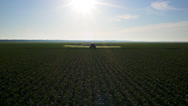 Stock Video Footage of Tractor Sprayer Wide aerial
