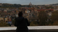 Woman takes photograph on IPhone of St Peters (model release) Stock Footage