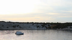 Motorboat in a Peaceful Cove 1 Stock Footage