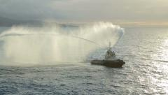 Fire fighting tug, water jet display to welcome cruise ship into harbour Stock Footage