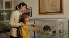 Tour of the museum, visiting museum,visitors watching artifacts Stock Footage