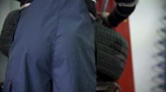 Vulcaniser checks the tire Stock Footage