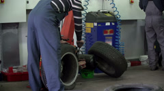 Vulcaniser is straightening the tire Stock Footage