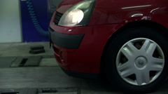 Red car drives into the auto mechanic parlour Stock Footage