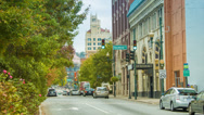 Stock Video Footage of Asheville, NC City Street with Traffic Between Historical Buildings
