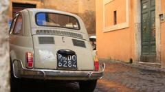 Original Fiat 500 car on a corner street in Rome 2 Stock Footage