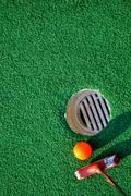 mini golf and green background - stock photo