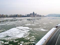 parliament of hungary and the icey river of danube - stock photo