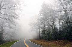 ice fog on a mountain road - stock photo