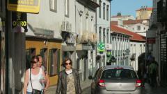People walking along road in ponta delgada, san miguel island, azores Stock Footage