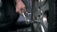 Loosening the screw on a tire Stock Footage