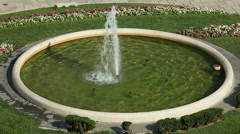 Fountain spray in circular pond Stock Footage