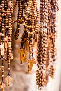 crosses sold in via dolorosa street market, jerusalem old city, israel. - stock photo
