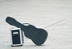Black guitar with amplifier isolated abandoned Stock Photos