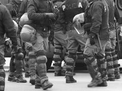 Policemen in war planning during a control of supporters Stock Photos