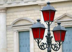 historical lantern with christmas red glass for street furniture - stock photo