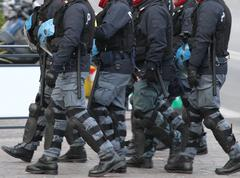 cops with divided with blackjack and blackjack during the riot - stock photo
