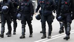 Policemen and vigilantes with bulletproof clothing Stock Photos