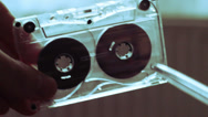 Stock Video Footage of Manually Rewind a Cassette Tape